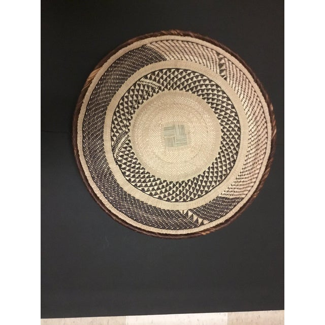 African Basket - Tonga - Zimbabwe Binga Basket Traditionally, the baskets were (and still are) used for carrying maize or...