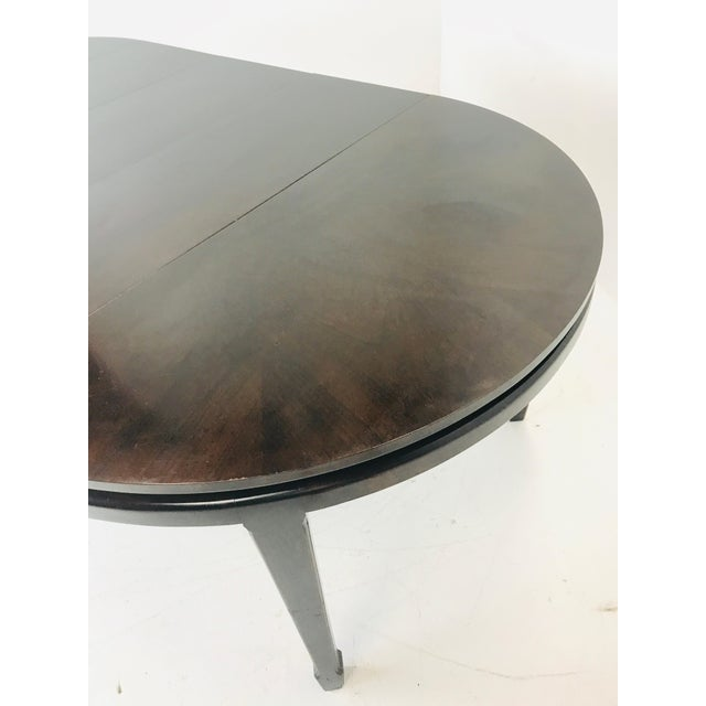 """Round 48"""" John Widdicomb dining table with 3 leaves and tapered legs. Three leaves measuring 15"""" x 48"""" each. Full..."""
