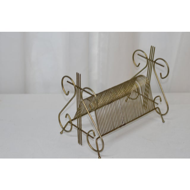 Vintage Brass Ornate Record Holder Scroll Design on the ends make for a unique and rare touch of class to the standard 45...