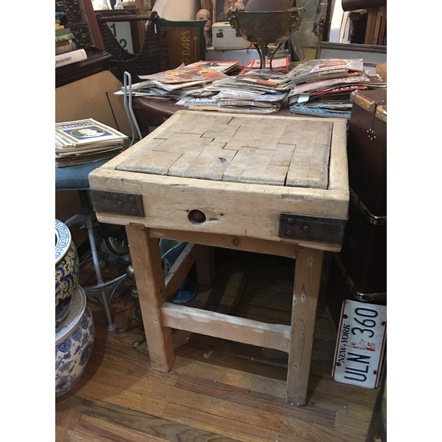 A great looking old English butcher block with a newer stand. A great addition to a kitchen. Heavy top reinforced by iron...
