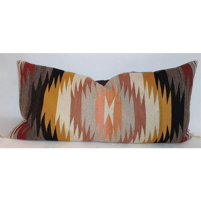 Navajo Indian weaving bolster pillows in fine condition. These were originally saddle blanket weaving's. The backing is in...