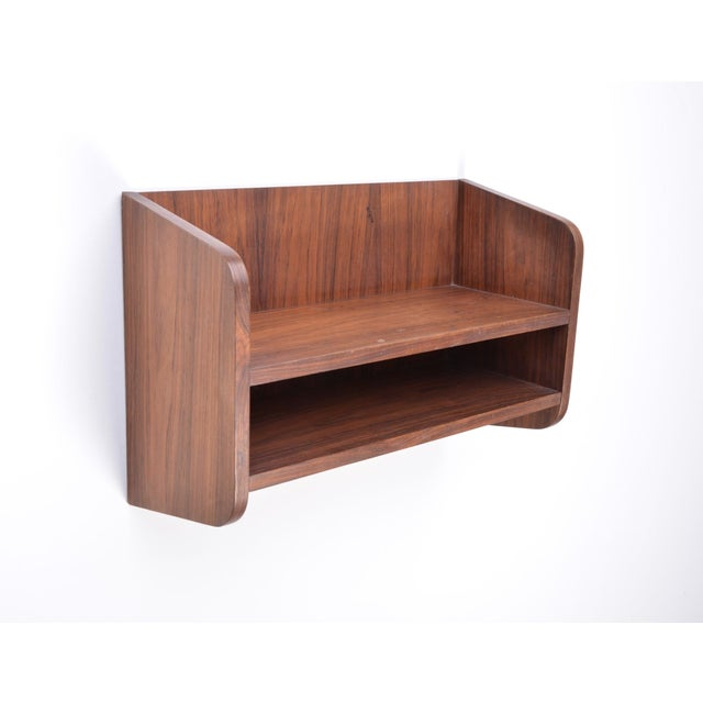 Vintage design Mid-Century Scandinavian small wall shelf Made in rosewood Produced in Denmark in the 1960s Beautifully...