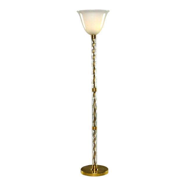Circa 1940s tall Murano glass floor lamp features thick, clear ribbed glass center support with brass hardware and base,...