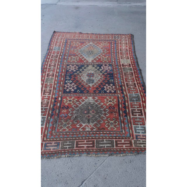 "Antique Caucasian Kazak 3'9""x7'6"" very low pile, vegetable dyed note: A 1910s distressed Kazak with areas of natural..."