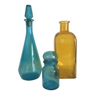 Vintage Mid Century Modern Aqua Blue & Yellow Glass Bottles - Set of 3 For Sale