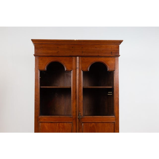 Brown Antique Dutch Colonial Tall China Cabinet With Glass Doors and Arched Motifs For Sale - Image 8 of 13