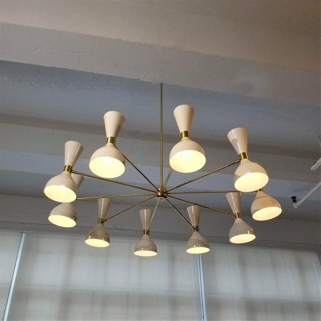 """Large 10-arm round """"Ludo"""" Chandelier shown in natural brass and our """"Perfect White"""" enamel fabricated in NYC by Blueprint..."""