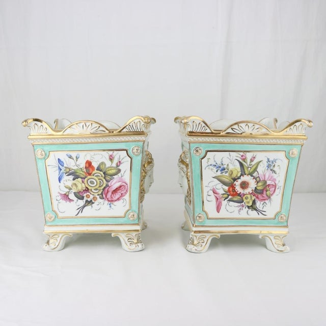 A pair of Swansea bough pots by Henry Morris, English, circa 1820. Early mark to underside of each lid. Flower decoration...