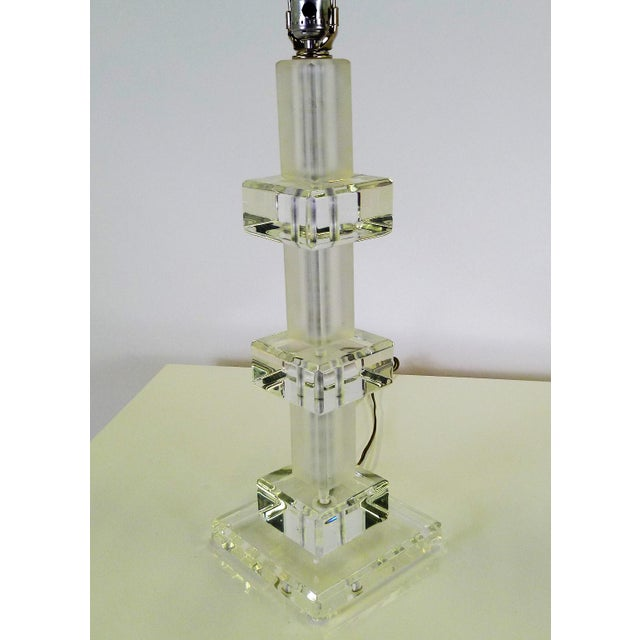 1970s Columnar Lucite Table Lamp consisting of lucite in stacked clear blocks and frosted tubular forms. In excellent...
