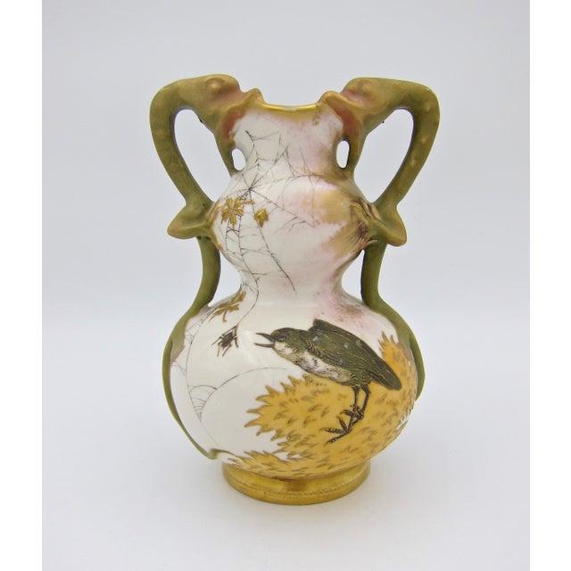 An antique Austrian vase of ivory porcelain by Riessner, Stellmacher & Kessel (RStK) Amphora of Turn-Teplitz, Bohemia...