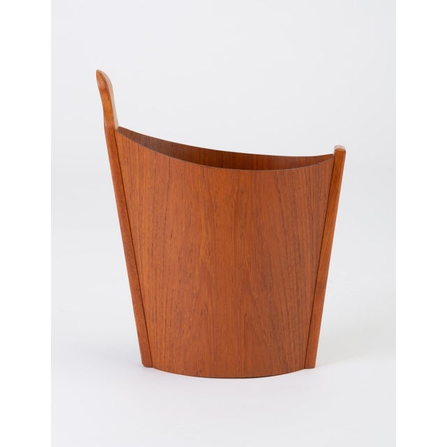 A wastebasket with delicate construction in teak wood, designed in Norway and marketed for export by Westnofa. The...