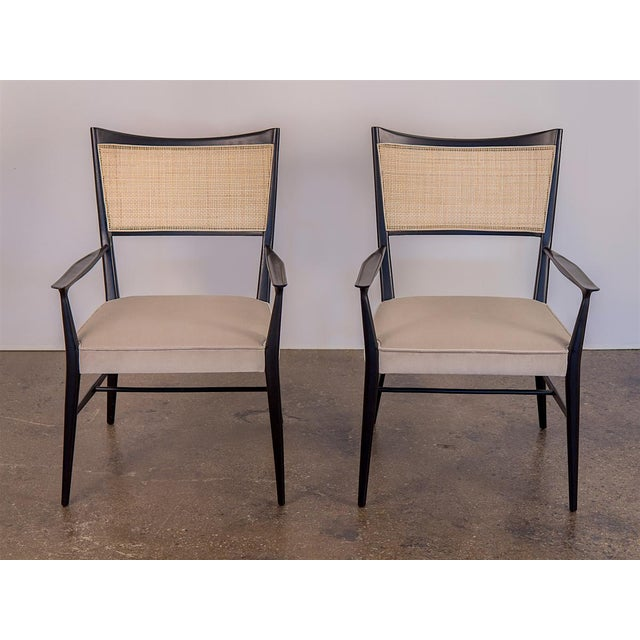 Refined pair of 1950s Paul McCobb Irwin occasional chairs. This pair has been carefully restored with an ebonized finish,...