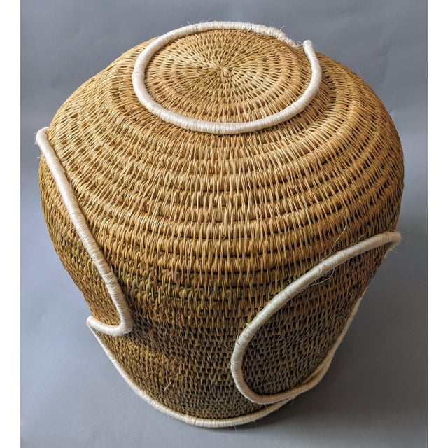 This handwoven seagrass basket is handmade by rural artisan women in the regions of Manzini, Shiselweni, and Hhohho,...