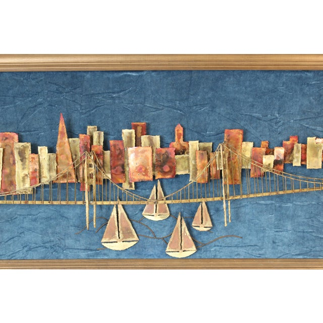 Mixed metal wall sculpture of the San Francisco skyline, Golden Gate Bridge and sailboats on a velvet back ground, circa...