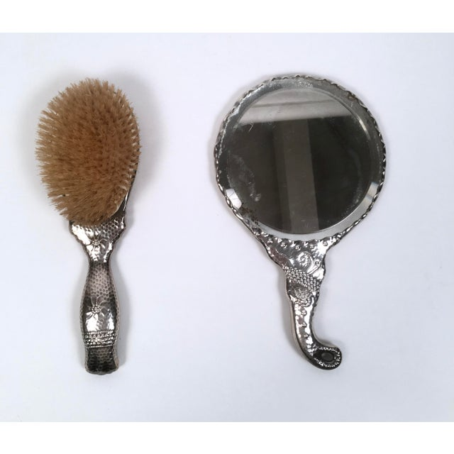 An Aesthetic Movement period sterling silver hand mirror and brush, American circa 1880, with unusual and 'modern'...