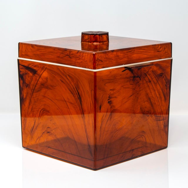 Circa 1970s square shaped ice bucked in a sheer, faux-tortoise lucite. Unknown maker. No flaws found. DEALER REFERENCE: 9608