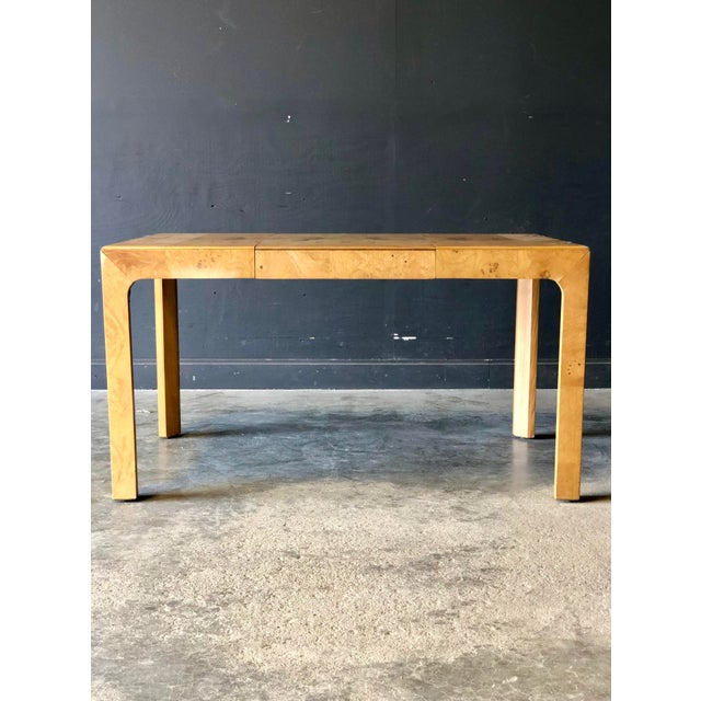 A sleek Milo Baughman parsons table in walnut. Can be used as a dining table with the additional leaf or square as a...