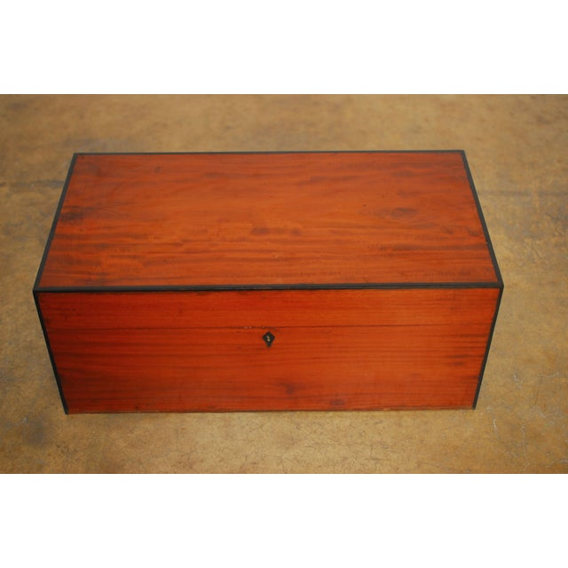 Vintage Anglo-Indian teak treasure chest known as a cash box with ebony accents on the edges. Used by merchants to store...