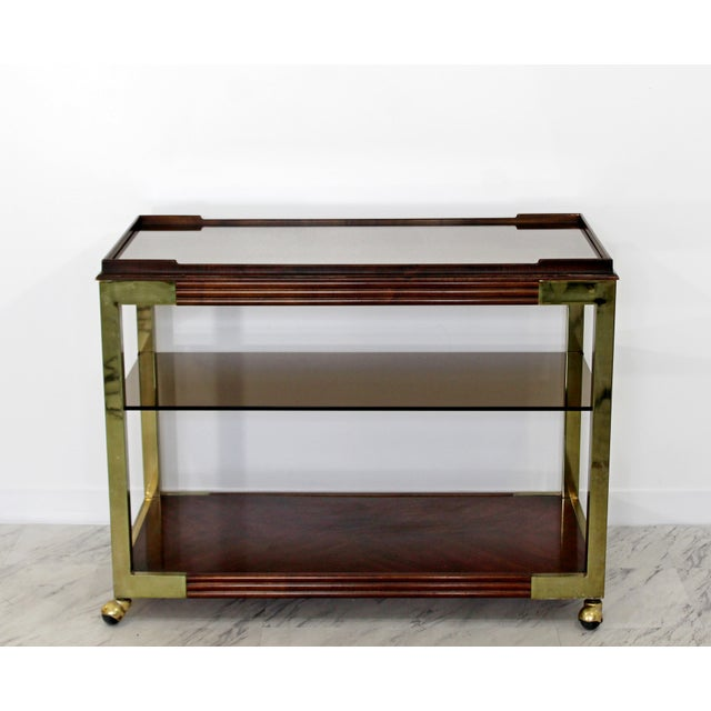 This is an incredible, two-tiered bar service cart by Drexel Heritage from the 1950s or 60s. The piece features a smoked...
