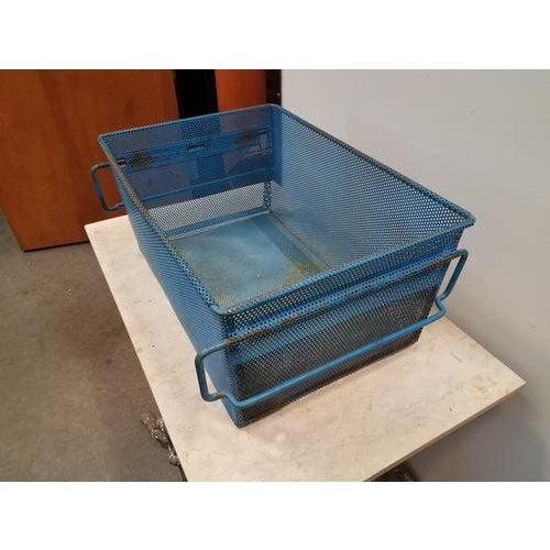 Great mid-century industrial French metal basket, with original blue paint. 2 available, these are very sturdy and great...