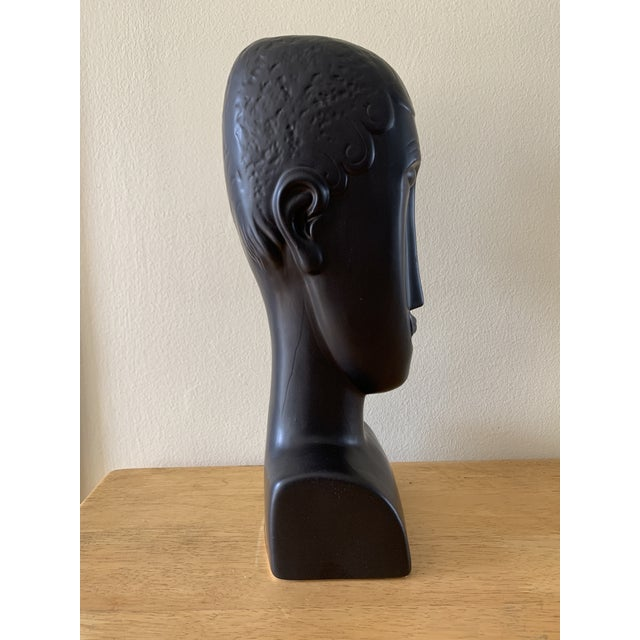 Fabulous elongated modern ceramic figural bust. Reminds me of a Modigliani subject with the whimsical long shape and face....