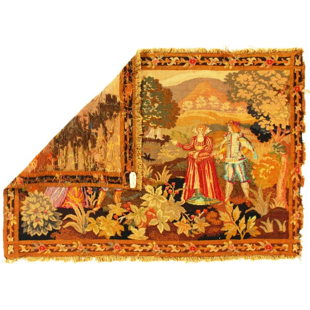 This is an antique French wall hanging tapestry. The piece dates back to the 1890s.