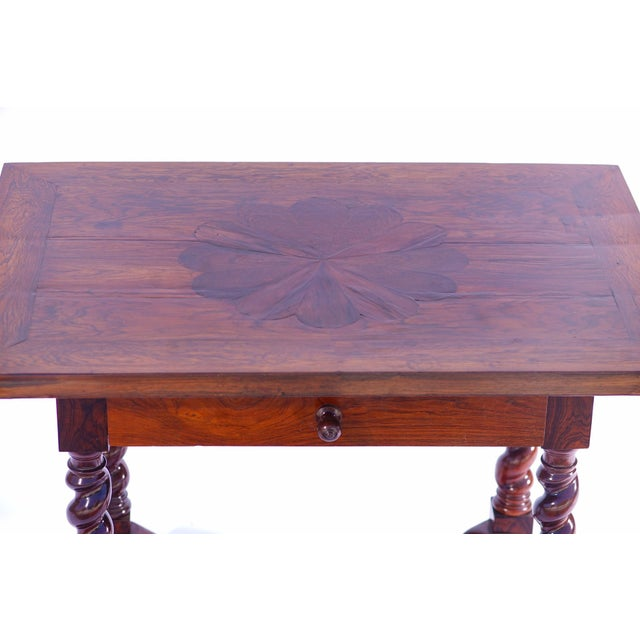 19th c. Portuguese Rosewood Table with inlaid flower detail This item includes restricted materials and can not be sold...