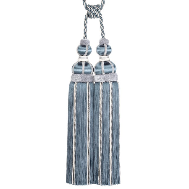 Elegant double tassel tieback in tones of grey-blue with beautiful satin wrapped moulds and gimp detailing. The top of the...