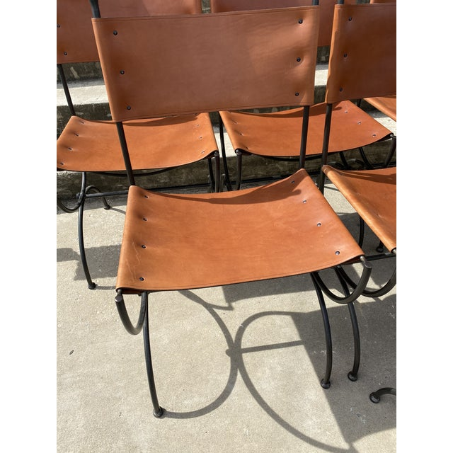 IYKYK. Incredible set of Charleston Forge hand made heavy black wrought iron and bridle leather dining chairs. This...