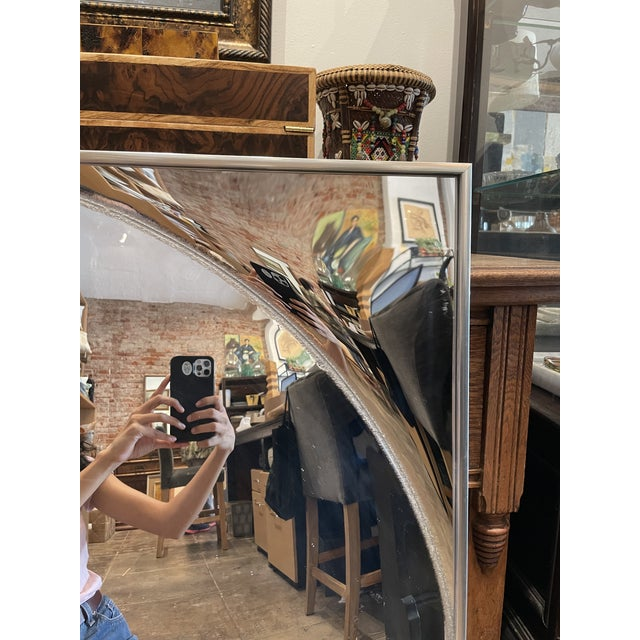 Square mirror with circular protruding convex mirror in the middle. A fun and interesting piece to go in any room in your...