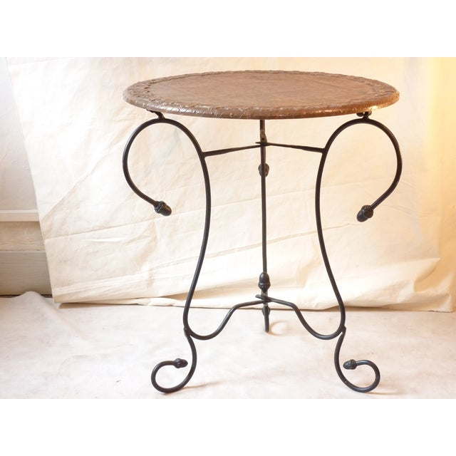 20th-century table with an iron base, acorn decoration, and a repousse copper clad top. Good plant table, end table, or...