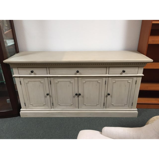 Design Plus Gallery has a Restoration Hardware St. James Credenza. The piece is finished in an Antique Off White . This...