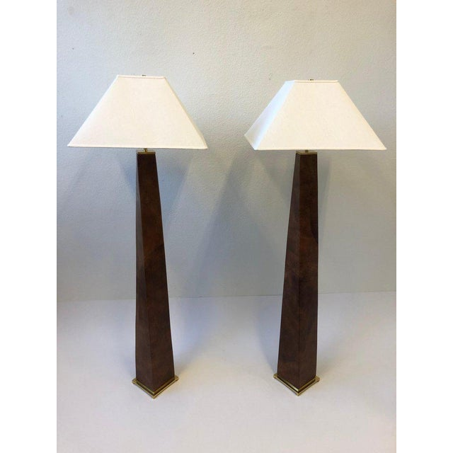 A spectacular pair of 1980's polish brass and leather J.M.F. floor lamps by renowned American designer Karl Springer. The...