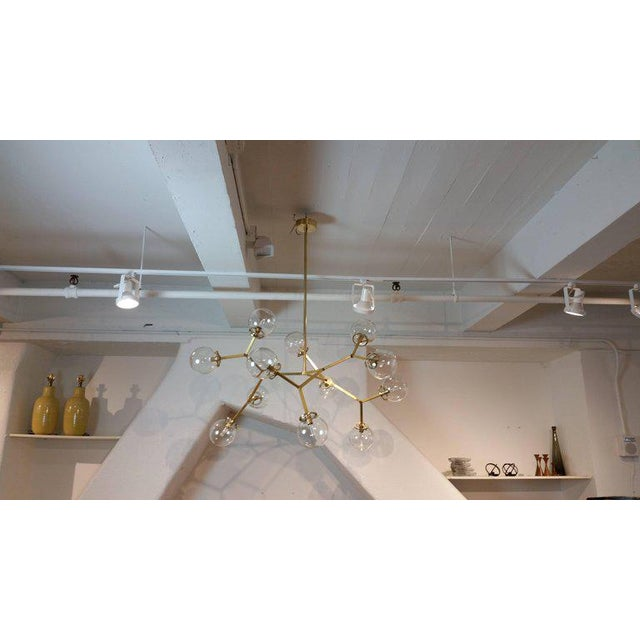 The Macro Molecular chandelier, model 525 sculptural brass and blown glass chandelier fabricated in NYC by Blueprint...