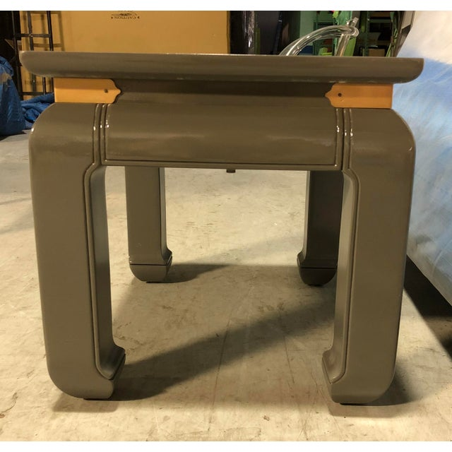 This pair of gray lacquered ming side tables are great accent pieces for any room. The shape of the leg definitely adds...