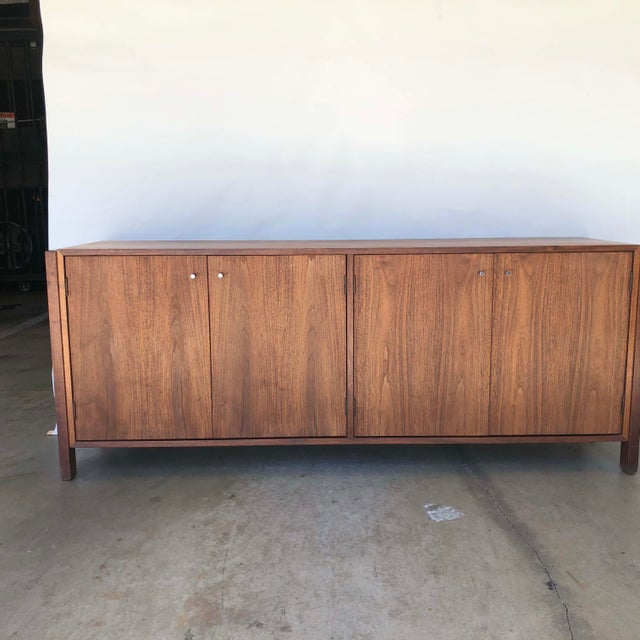 A Walnut Mid-Century Modern Credenzas. In VG++ condition. Some of the inner shelves had been lined with removable liner...