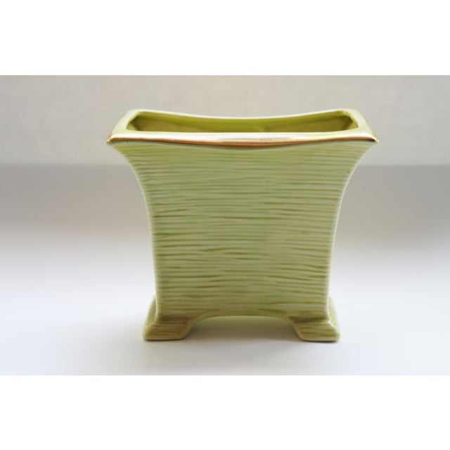 MCM lime green and gold planter with gold accents. No maker's mark.