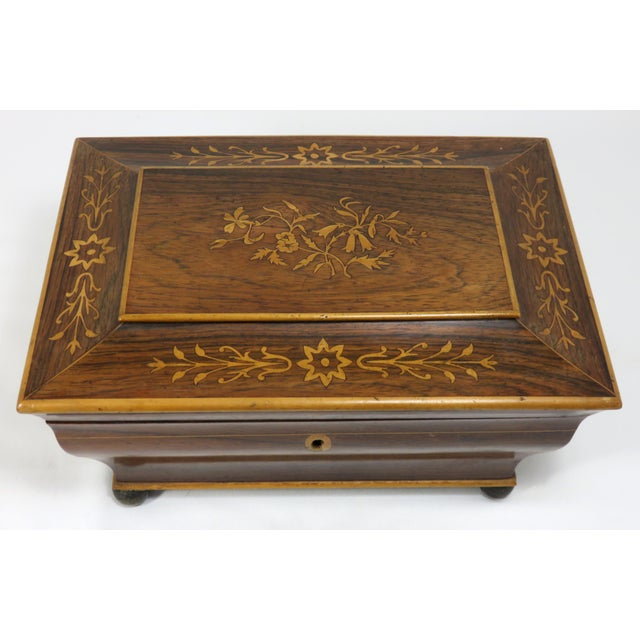 A very fine quality antique sewing box. It has genuine Brazilian Rosewood Veneer with boxwood Floral marquetry - inlay...