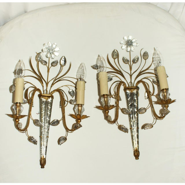 Pair of icicle motif cut glass & gilt metal wall sconces. French, c. 1950s, Bagues. With gilt floral tendrils and cut...