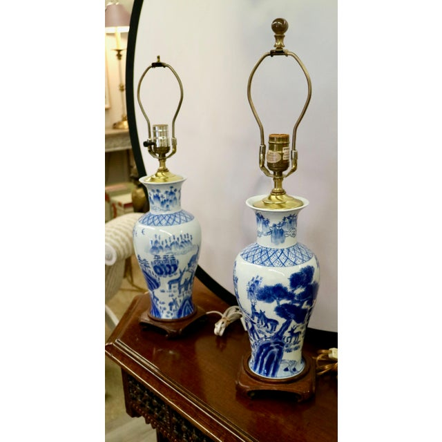 Pair of Blue & White Asian Lamps. Finial is missing on one of the lamps. Aside from that they are in great condition.