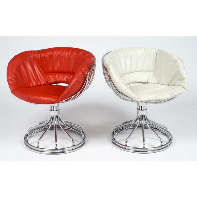Vintage chrome chairs in the style of Warren Platner for Knoll, with red and white vinyl cushions.