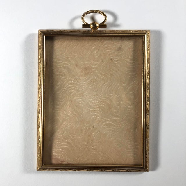 A wonderful traveling picture frame with its original bowed glass and fitted leather case. The case ingeniously opens so...
