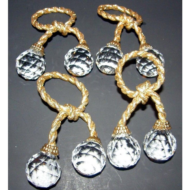 Set of 4 vintage Hollywood Regency crystal prism ball napkin rings. Metallic gold braided rope with round cut acrylic...
