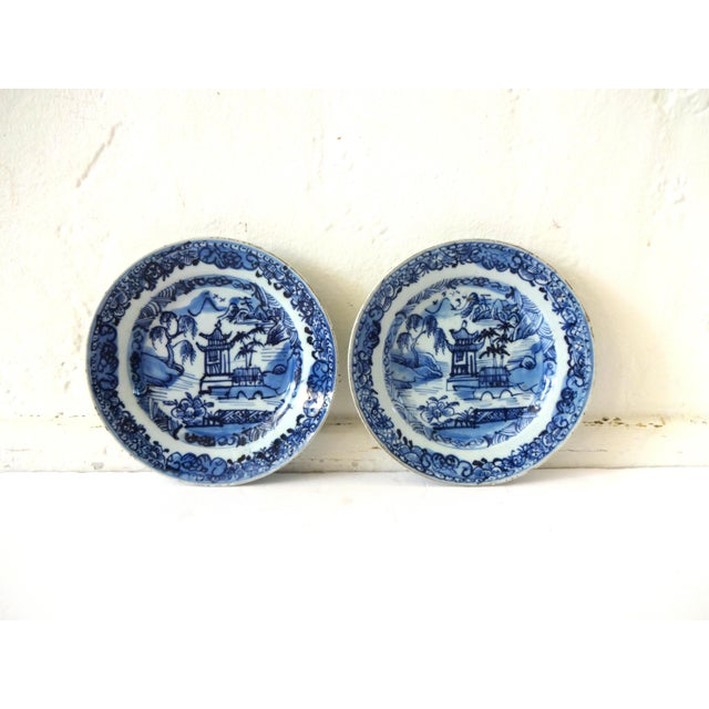 A pair of antique Chinese plates from the Kangxi period, c. 1662-1722. Blue and white -- the white is almost celadon. The...
