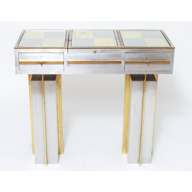 Modern diminutive vanity table and stool, made in circa 1970 in stainless steel and chrome-plated steel, brass, glass and...
