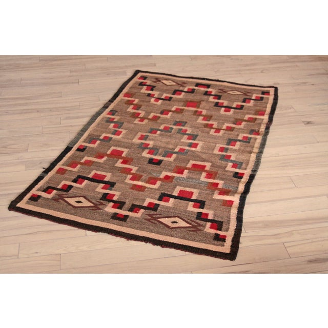 This is the most beautiful example of Navajo Native American style weaving that we have encountered. The rare geometric...