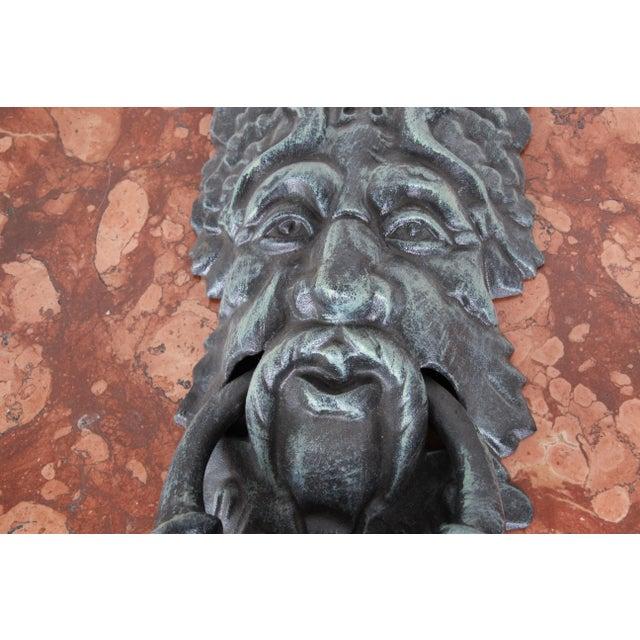 """A unique cast iron verdigris """"Green Man"""" face door knocker 20th Century Measures: 8""""W x 3""""D x 19.5""""H Excellent condition."""