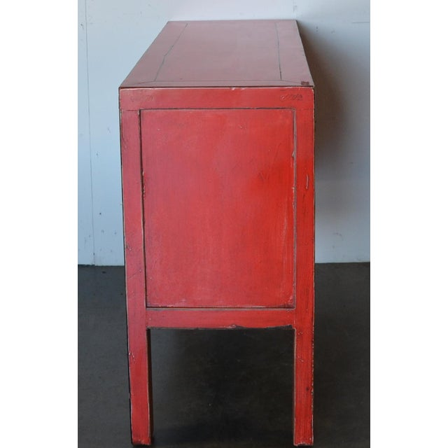 A very fun, vibrant, and whimsical red lacquer make this the quintessential Chinese modern piece of furniture. The drawers...