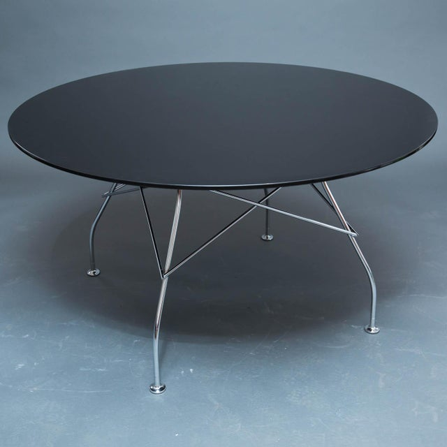 Nice modern table with chrome base and high-gloss lacquered top.