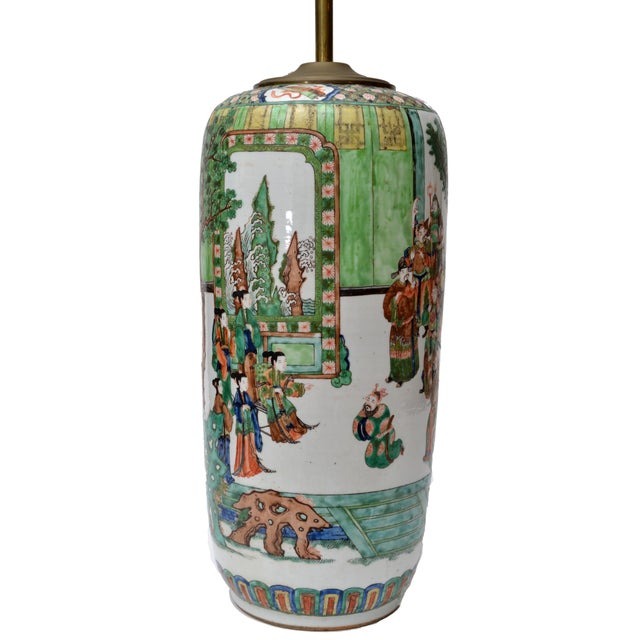 Antique Chinese porcelain table lamp hand-painted, which displays people in their daily life. Brass shaft and double...